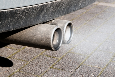shutterstock_dirty dual exhaust pipes of a car, failed emission test